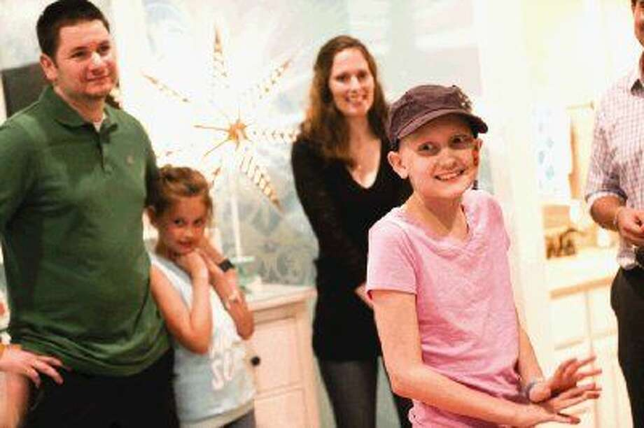 Twelve-year-old Ellie Fenter, who is battling leukemia, is excited to see her newly remodeled room on Monday, Sept. 28, 2015, at her family's home in Spring. To view more photos from the reveal, go to HCNPics.com. Photo: Michael Minasi