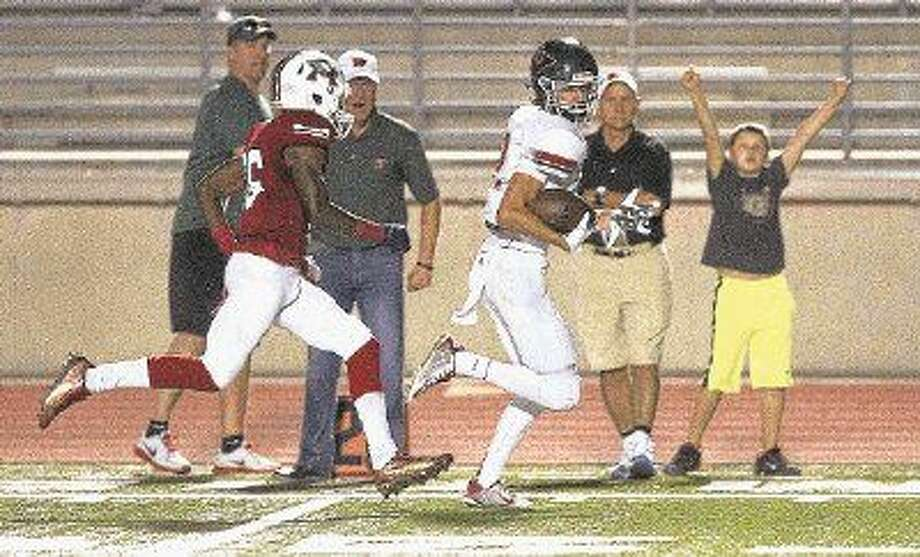 The Woodlands wide receiver Hunter Moore scores against Atascocita in the Highlanders' 38-14 victory. Moore is The Courier's Montgomery County Player of the Week. Photo: Jason Fochtman
