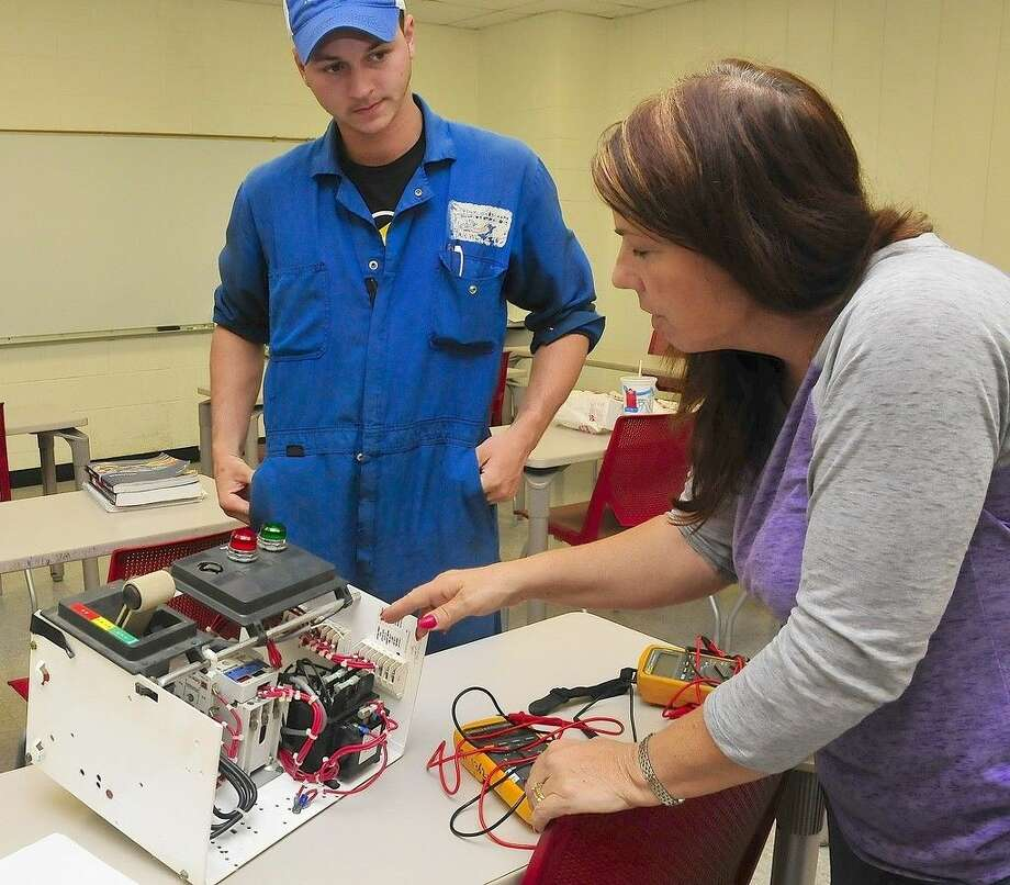 (left) Dustin Richardson is an electrician helper with Triad Electric and Control and is taking classes to move up as a journeyman, paid for by his employer, through the San Jacinto College Continuing and Professional Development division. (right) Lynn Hobbs is a project manager and master electrician for Austin Industrial who teaches night classes at the College to train those new to the industry and help existing workers, like Richardson, to upskill. Photo credit: Jeannie Peng-Armao, San Jacinto College marketing, public relations, and government affairs department.