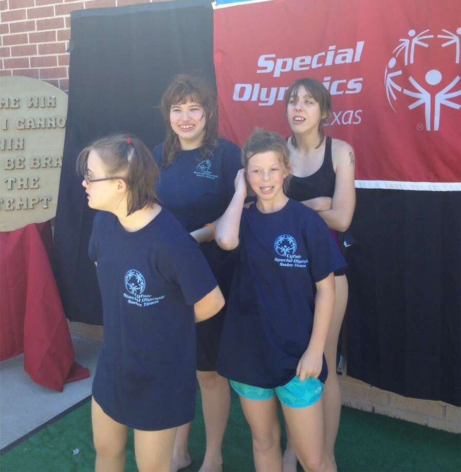 From left to right, CFISD swimmers Taylor Rhule, Caitlin Ripley, Julia Mostyn and Jill Philipbar celebrate their gold medal in the 4x25-meter relay at the Special Olympics of Texas Area 4 Swim Meet on Oct. 4. Photo: Submitted Photo