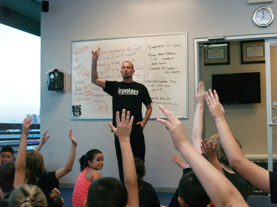 Coach Trea Drake asks how many of the students present had ever been bullied. Drake taugh students how to avoid bullies in their schools in an anti-bully seminar on Friday, Oct. 2