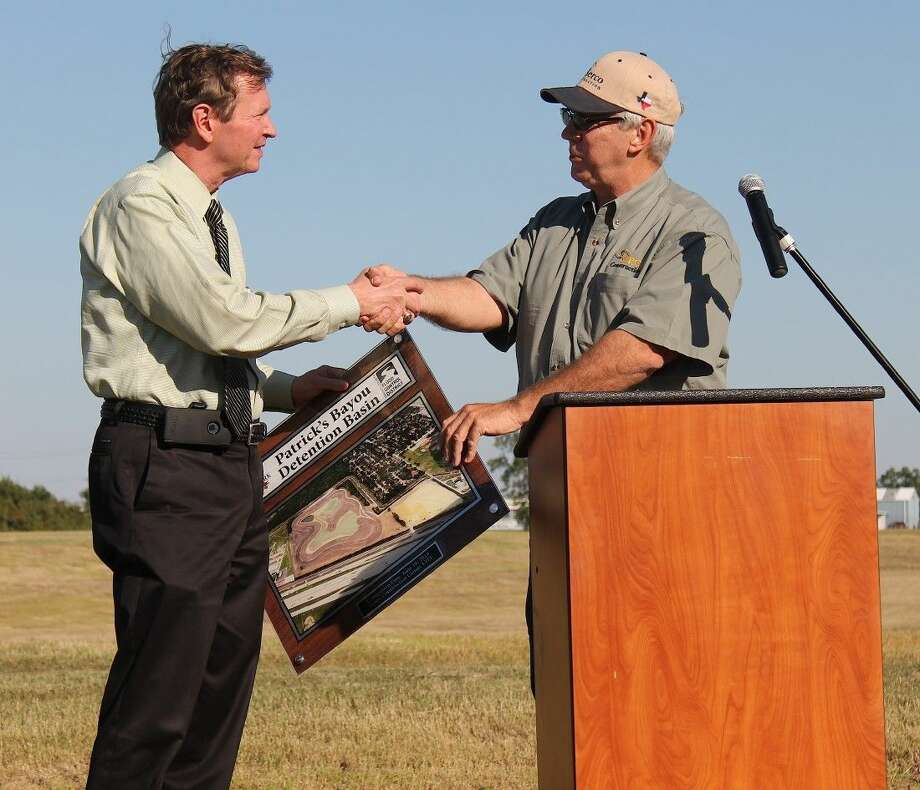 Gary Conaway presents plaque to City Manager Jay Stokes. Photo: Stacey Glaesmann