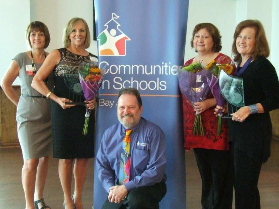 CIS-Bay Area's 25th anniversary was celebrated by (from left) Jane Sweeney, president of the Board of directors; Janet Summers, program director; Peter Wuenschel, executive director; retiree Viola Sanchez, and Linda Deckert, campus coordinator at Clear Springs High School.