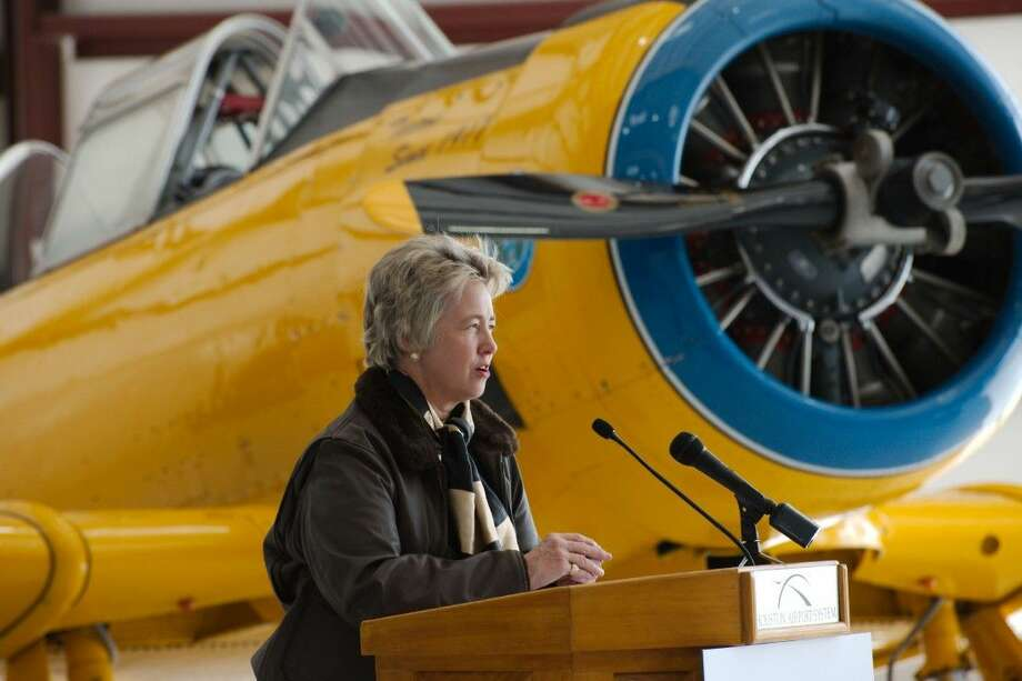 Houston Mayor Annise Parker speaks during a ceremony to celebrate the relocation of the Lone Star Flight Museum to Ellington Airport Monday, Oct. 27. Photo: Kirk Sides