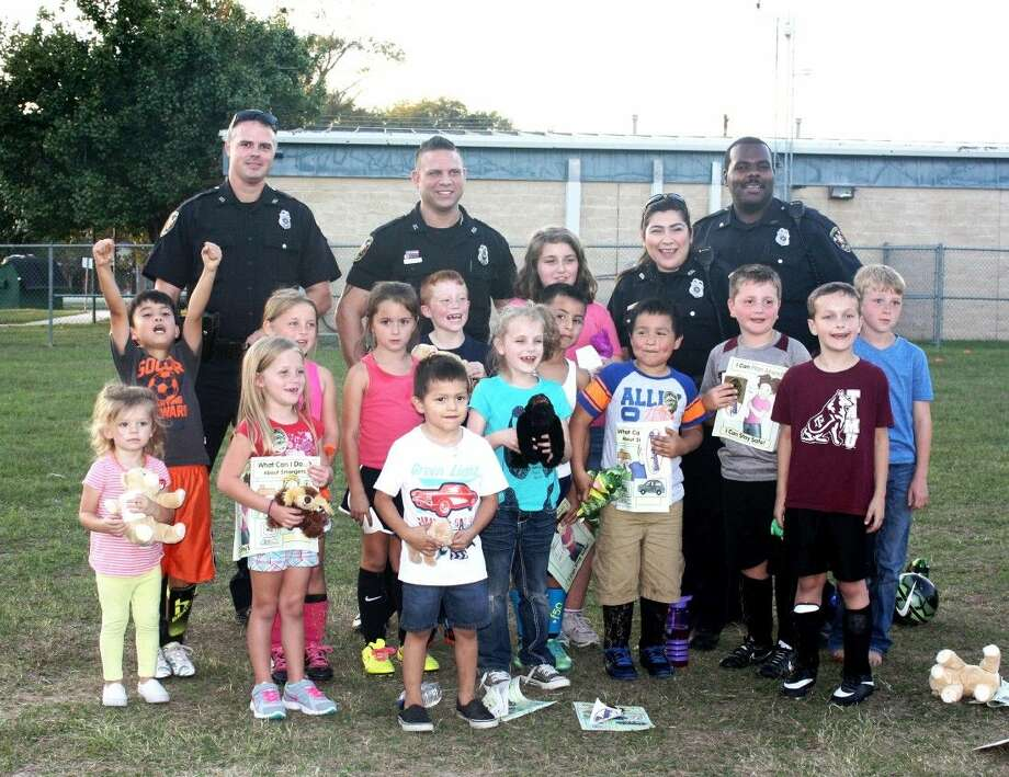 Cleveland Police Department Zack Harkness, George Suarez, Erica Fleming and Jarrod Morton visit a group of children at Southside Primary during National Night Out on Tuesday, Oct. 6. Photo: Stephanie Buckner