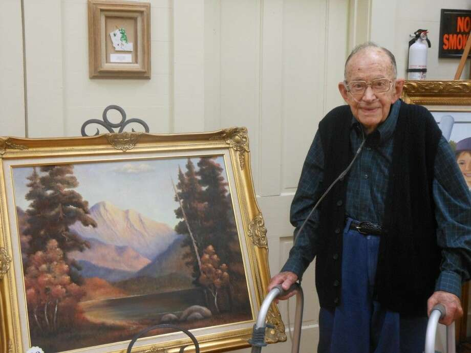 M.W. Ford stands next to some of his artwork. He and his wife, Dorothy, were honored with a tribute on Oct. 18-19. Ford died peacefully at home on Oct. 19. Photo: Submitted