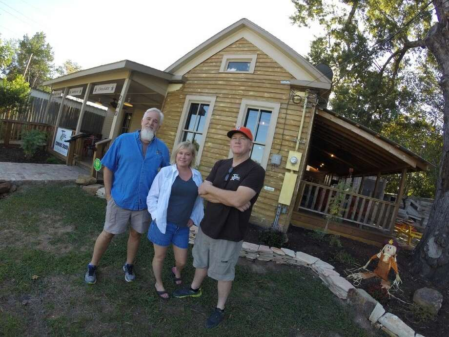 Scott Moore Jr., Michelle Holland and Greg Moore at Tejas Chocolate on North Elm Street. Photo: Submitted