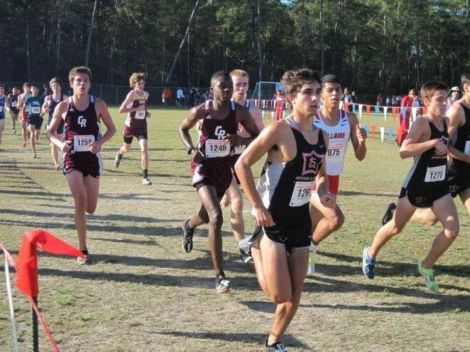 Chandler Rathke (far right) and Seven Lakes won the District 19-6A boys cross country championship, outrunning Strake Jesuit. Photo: Jack Marrion