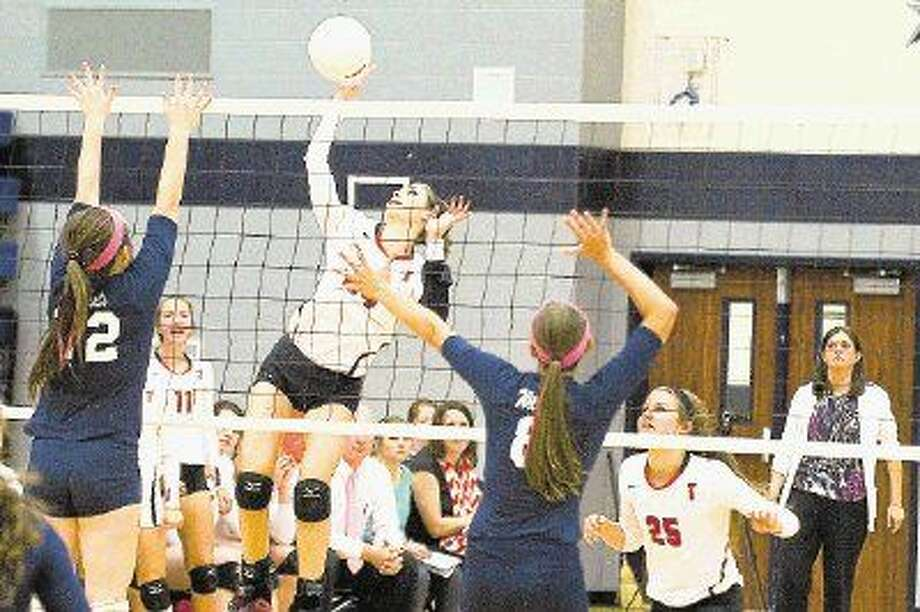 Tomball's Marie Pierce goes up for the kill during a match earlier this season.