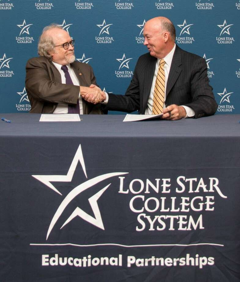 Dr. Richard Berry, Steven F. Austin University provost and vice president of academic affairs (pictured left) shakes hands with Steven C. Head Ph.D., Lone Star College chancellor after signing an articulation agreement to formalize a pathway for easier student transfers from a two-year degree at LSC on to a four-year degree at SFA. Photo: Submitted Photo