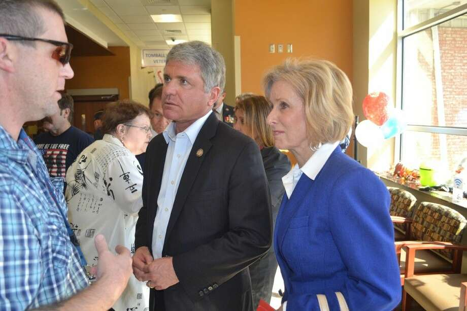 Congressman Michael McCaul and State Rep. Debbie Riddle speaks with a Veteran after the one year anniversary ceremony.
