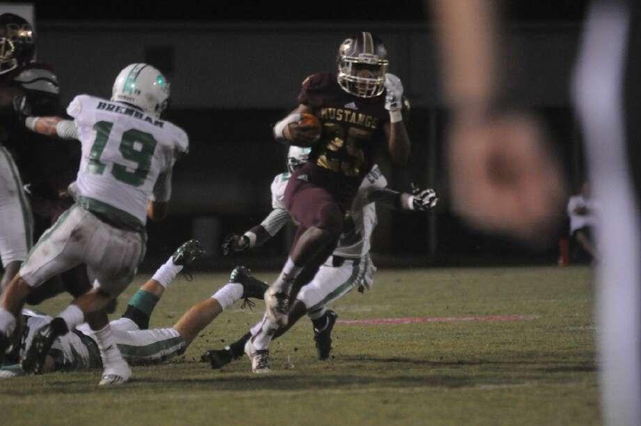 Magnolia West's Aaron Thomas finds running room against Brenham last Friday in Magnolia.