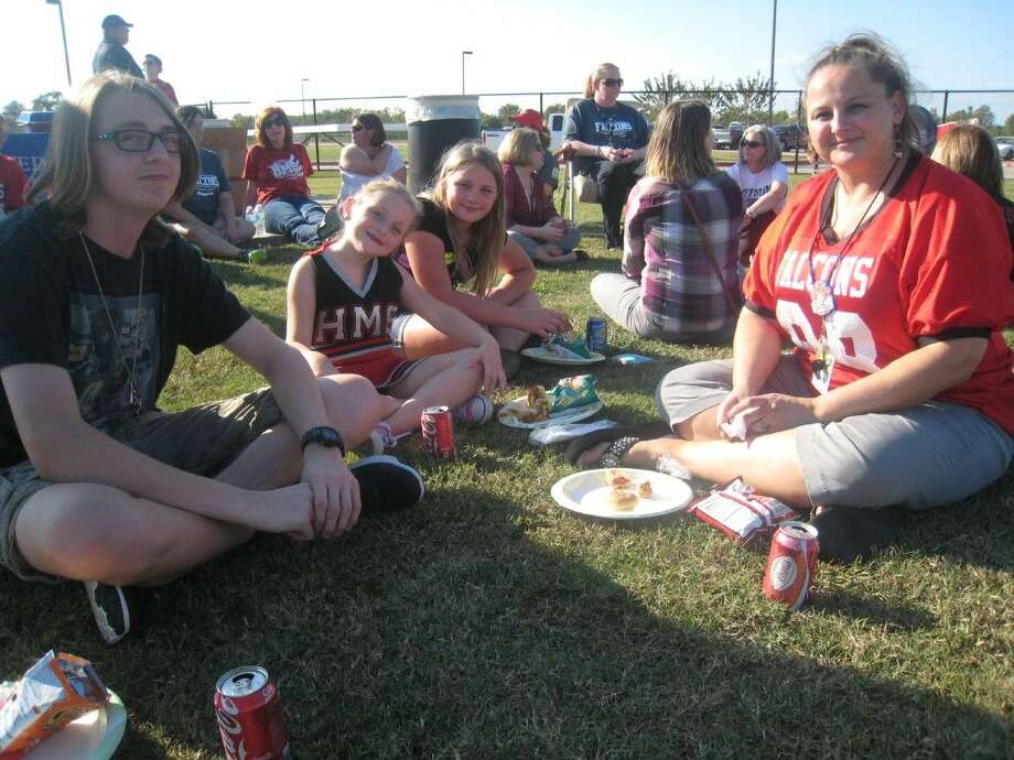 Families, students and teachers enjoyed hot dogs at the Huffman Middle School tailgate party before the school's football game Tuesday, Oct. 6, 2015.