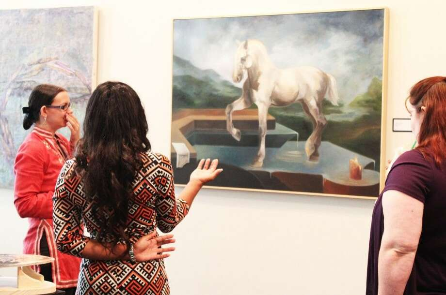 Oct. 23 marked the reception, giving students, staff, and the community a chance to explore and discuss the works directly with the artist and learn more about the art program. Photo: Minza Khan
