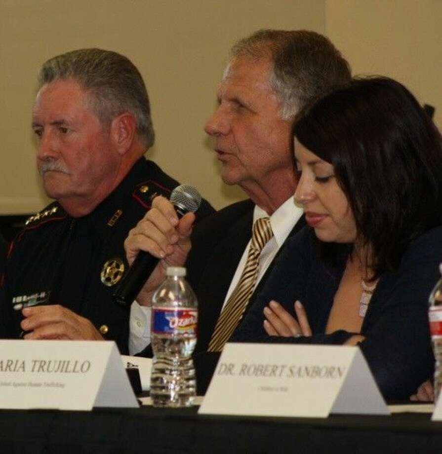 Pictured from left are Harris County Pct. 4 Constable Ron Hickman, Congressman Ted Poe and Maria Trujillo, executive director of United Against Human Trafficking. Photo: Submitted Photo