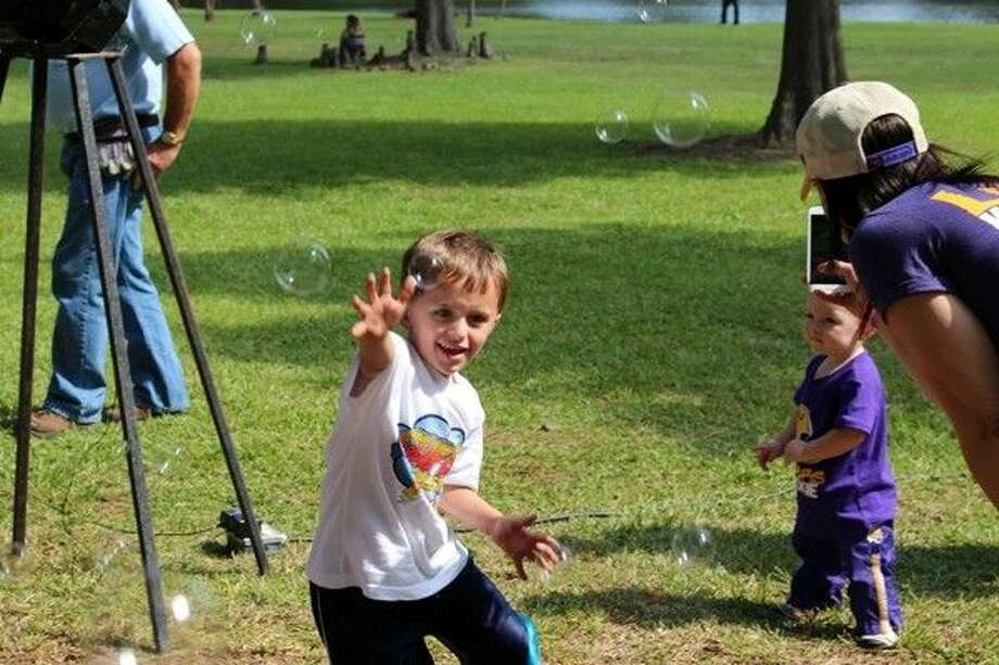 Brayden Busa chases bubbles during Sunday Afternoon in the Park at Burroughs Park in Tomball. Photo: Submitted Photo