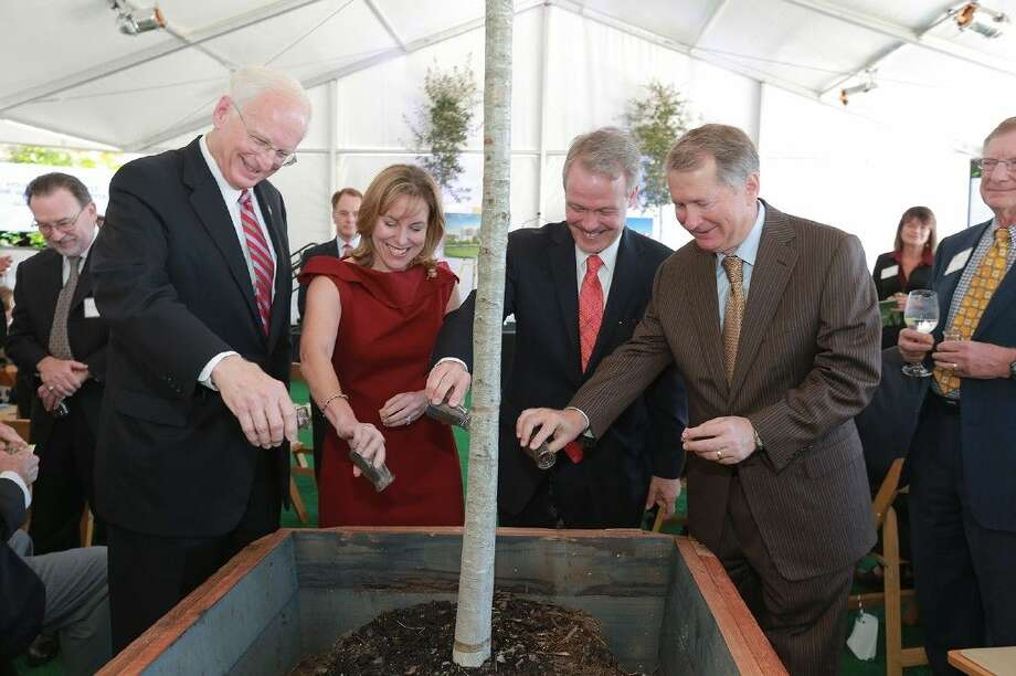 Ewing Werlein, Jr., Debbie Sukin, Marc Boom, M.D., and Pastor Ed Robb pour soil around the roots of a young live oak tree at Tuesday's groundbreaking ceremony for Houston Methodist The Woodlands Hospital. The tree will be cared for until it is planted at the hospital when it opens in 2017. Photo: Submitted Photo