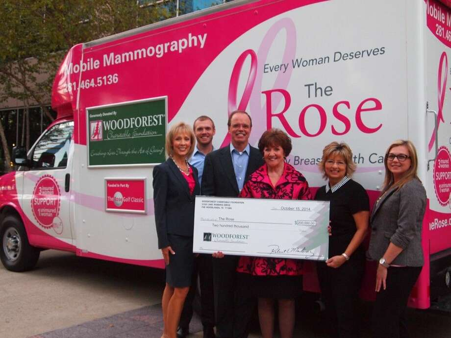 Woodforest Charitable Foundation recently presented a major gift to help The Rose add a fourth mobile mammography unit. From left: Kim Marling, WCF; Charlie Marling, WCF; Robert Marling, Woodforest National Bank; Dorothy Gibbons, The Rose; Vicki Richmond, WCF; and Amy Hegemeyer, WCF.