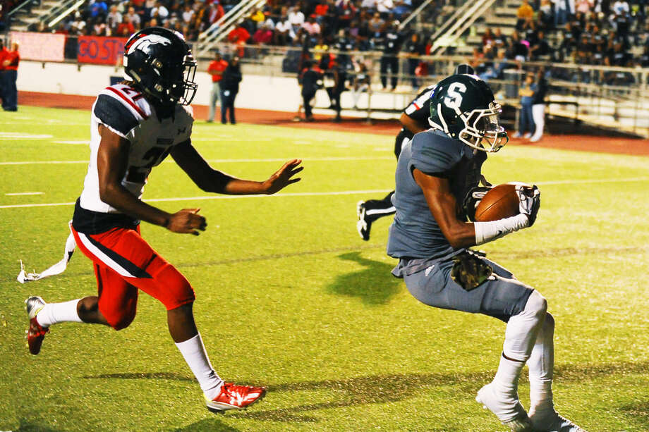 Spring Lion Deonta Adams (6) catches a 50-yard touchdown pass last Friday night against Spring Westfield. The game ended early following a brawl and was declared a forfeit by both squads. Photo: Tony Gaines