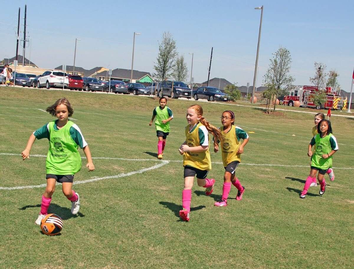 It's time to take the field! Pearland United Youth Soccer Club players enjoy a day in the sunshine at the new Hickory Slough Sportsplex.
