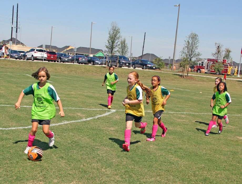 It's time to take the field! Pearland United Youth Soccer Club players enjoy a day in the sunshine at the new Hickory Slough Sportsplex. Photo: Kristi Nix