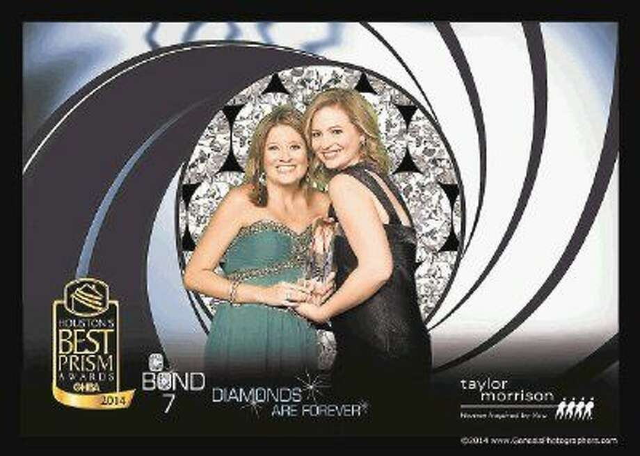 Two members of Bridgeland's marketing department hold the Greater Houston Builders Association's (GHBA) 2014 'Event of the Year' award. Pictured from left are Martha Gros, Bridgeland's Marketing Coordinator, and Audrey Roeder, Bridgeland's Public Relations Coordinator. Photo: David Postma