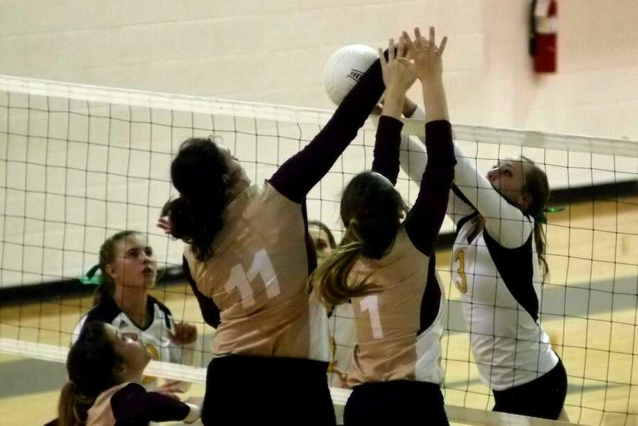 This was the Tarkington-Liberty match in a nutshell Tuesday night, Oct. 6. The two-and-a-half-hour long match ended with the LadyHorns just edging out the Panthers by two points in the final tie-breaker set to win, 3-2. Photo: Casey Stinnett