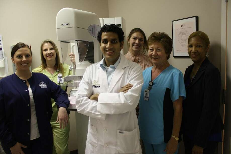 Radiologist Breast Specialist Dr. Chirag Parghi with The Breast Center team at Kingwood Medical Center.