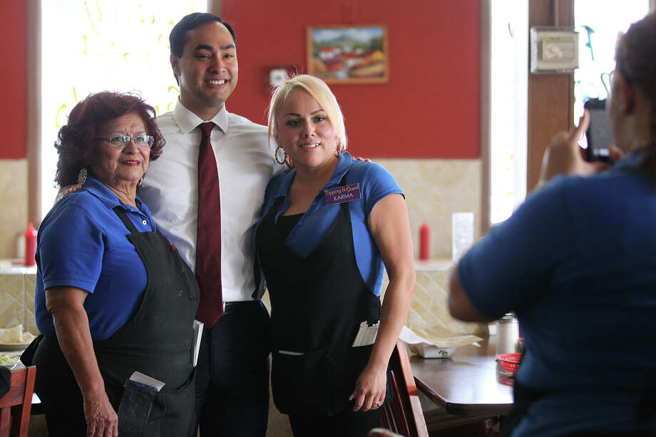 Malt House wait staff Gloria Ricondo, 70, left, and Maria Trevino, 28, (tilde over n), get their picture taken with U.S. Congressman Joaquin Castro, Tuesday, May 28, 2013. Photo: JERRY LARA, Staff / San Antonio Express-News / © 2013 San Antonio Express-News