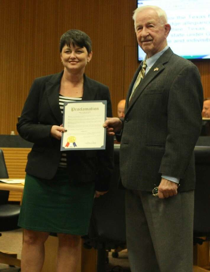 Mayor Tom Reid presents a proclamation declaring Nov. 8 to be Pearland Arbor Day to Michelle Graham, Director of Parks and Recreation. Photo: Stacey Glaesmann