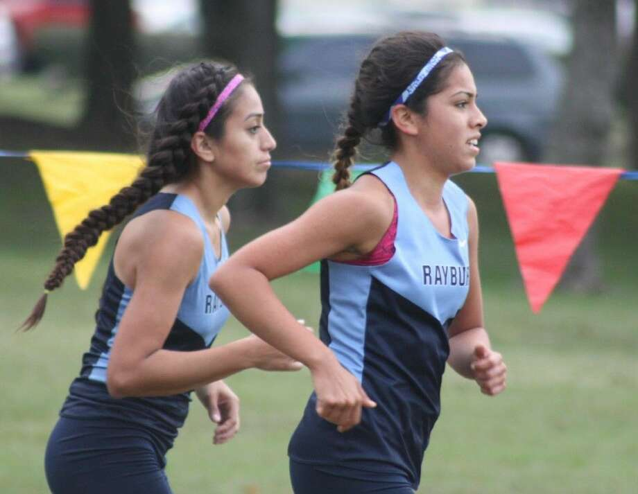 Sam Rayburn's Yazmin Garcia and Raquel Resendiz will be two of the seven PISD individuals in the Class 6A Region III run, set for 12:30 Saturday afternoon. Photo: Robert Avery