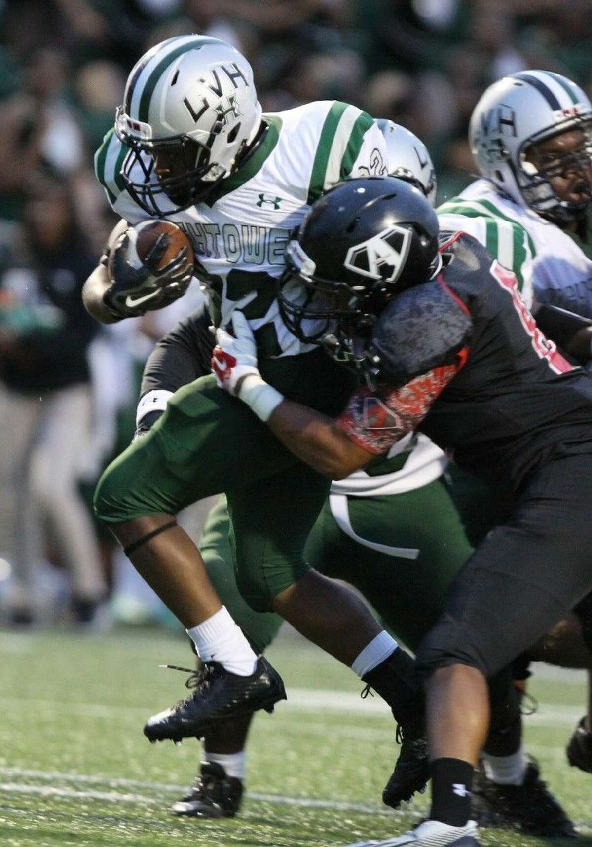 Hightower's LaGeorge Allen runs against Austin's Zach Davis, Sept. 12 at Mercer Stadium in Sugar Land. To view or purchase this photo and others like it, go to HCNPics.com.