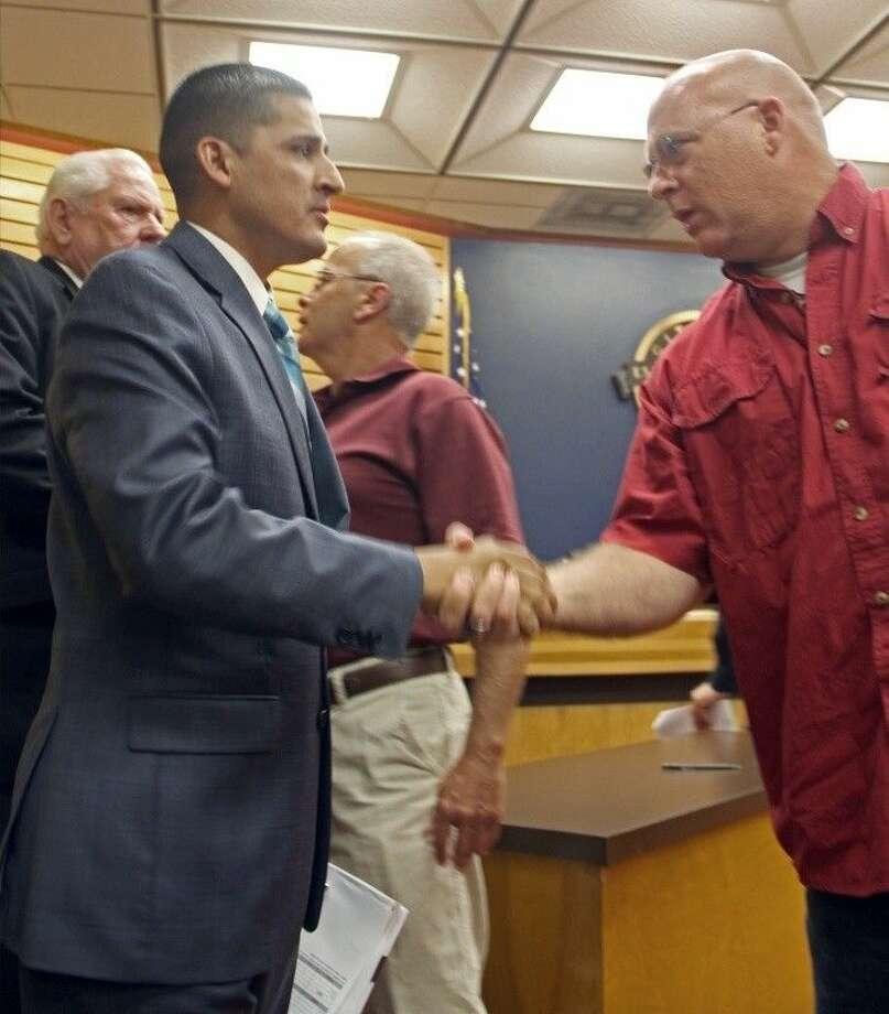 Councilmember Ornaldo Ybarra (left) received a warm welcome from several retired city workers after the council meeting. Photo: Kristi Nix/The Citizen
