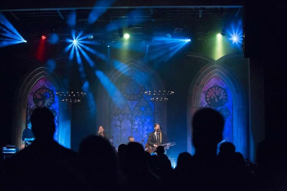 Musician leads worship at the Loft.