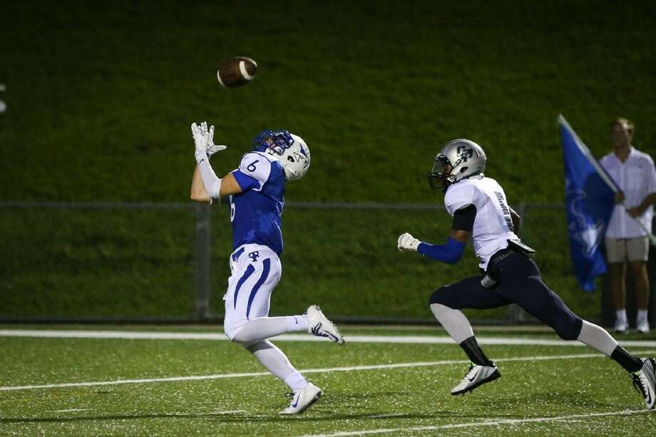Taylor's Jacob Yohr (6) scores a touchdown against College Park, Sept. 11 at Rhodes Stadium. To view or purchase this photo and others like it, go to HCNPics.com. Photo: Michael Minasi