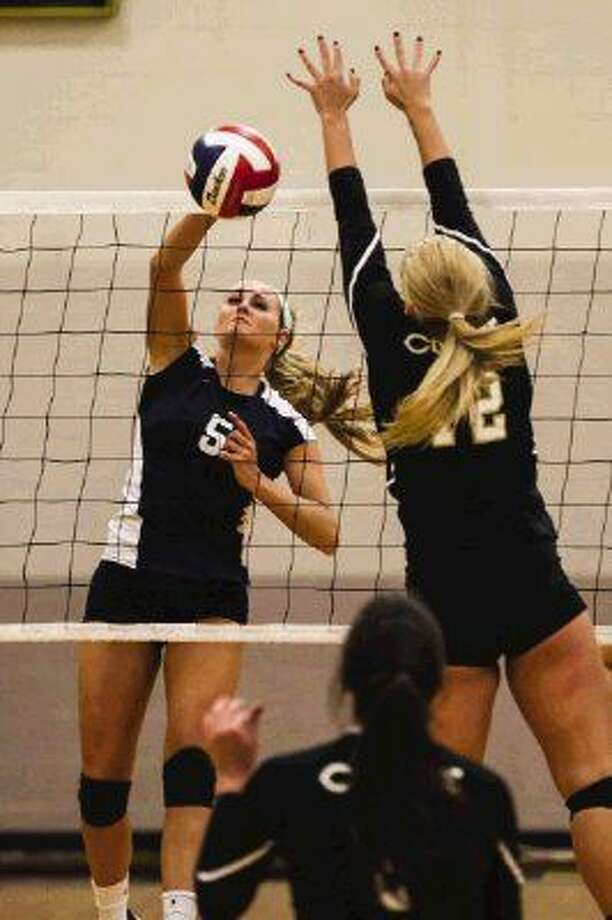 College Park's Macey Rabson spikes the ball against Conroe. College Park won in straight sets. To view or purchase this photo and others like it, go to HCNPics.com.
