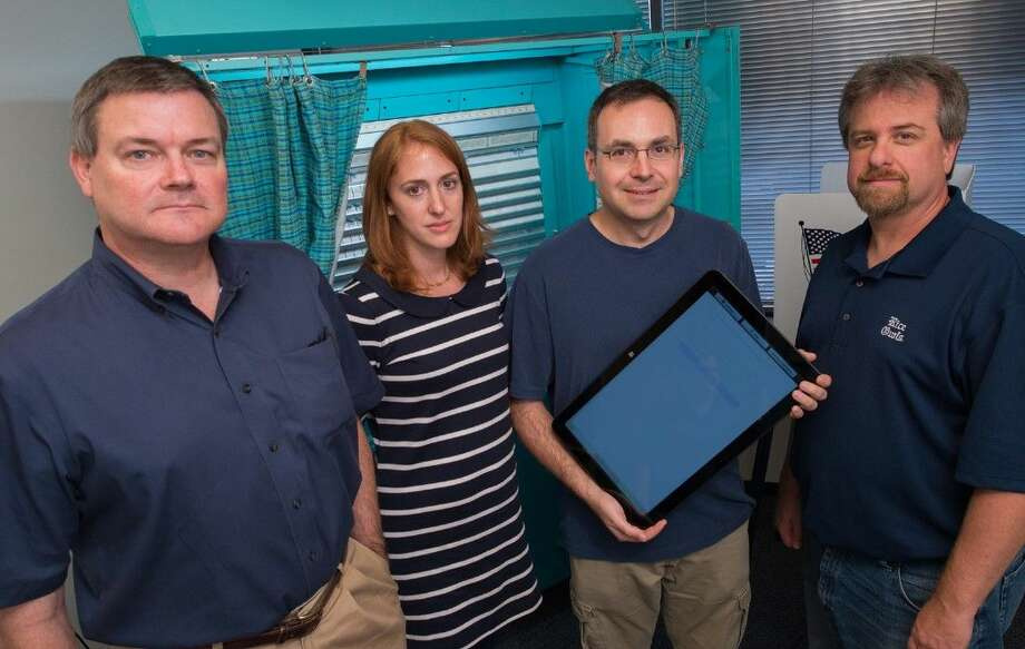 Rice experts (from left) Phil Kortum, Claudia Ziegler Acemyan, Dan Wallach and Mike Byrne are working to design a new electronic voting system that is both secure and easy to use. Photo: Jeff Fitlow