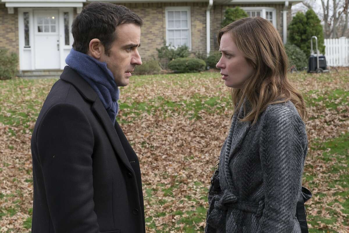 """In this image released by Universal Pictures, Justin Theroux, left, and Emily Blunt appear in a scene from, """"The Girl on the Train."""" (Barry Wetcher/Universal Pictures via AP)"""