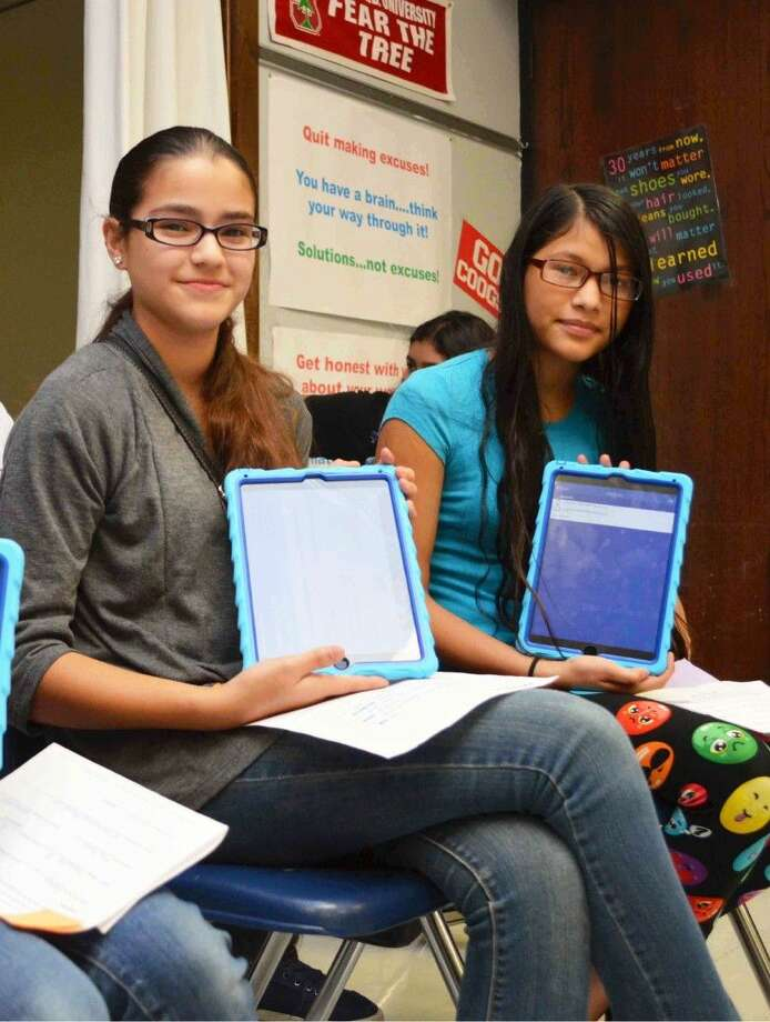 Deepwater Junior High seventh-graders Nelly Alvarado and Daniela Reyes proudly show-off their new iPads they will use this school year through Deer Park ISD's new initiative, Empower 1:1. Photo by Jeri M. Martinez/DPISD Communications