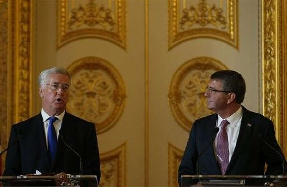Britain's Secretary of State for Defence Michael Fallon, left, speaks during a press conference held with the U.S. Secretary of Defense Ashton Carter at Lancaster house in London, Friday. Photo: Alastair Grant