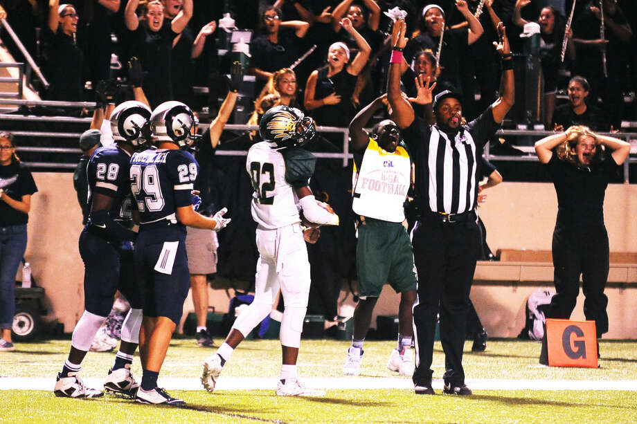 Cy Fall sophomore wide receiver TayJon Martin watches the referee make the call on his touchdown catch, sealing victory for the Golden Eagles. Photo: Tony Gaines