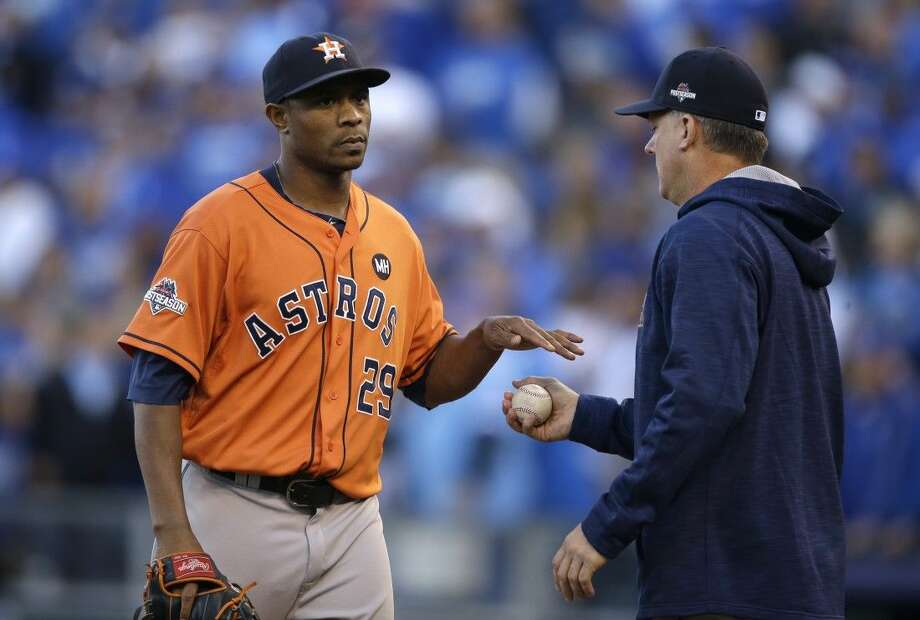 Houston Astros relief pitcher Tony Sipp, left, reacts as he is taken out by manager A.J. Hinch during the eighth inning of Game 2 against the Kansas City Royals, Friday in Kansas City, Mo.