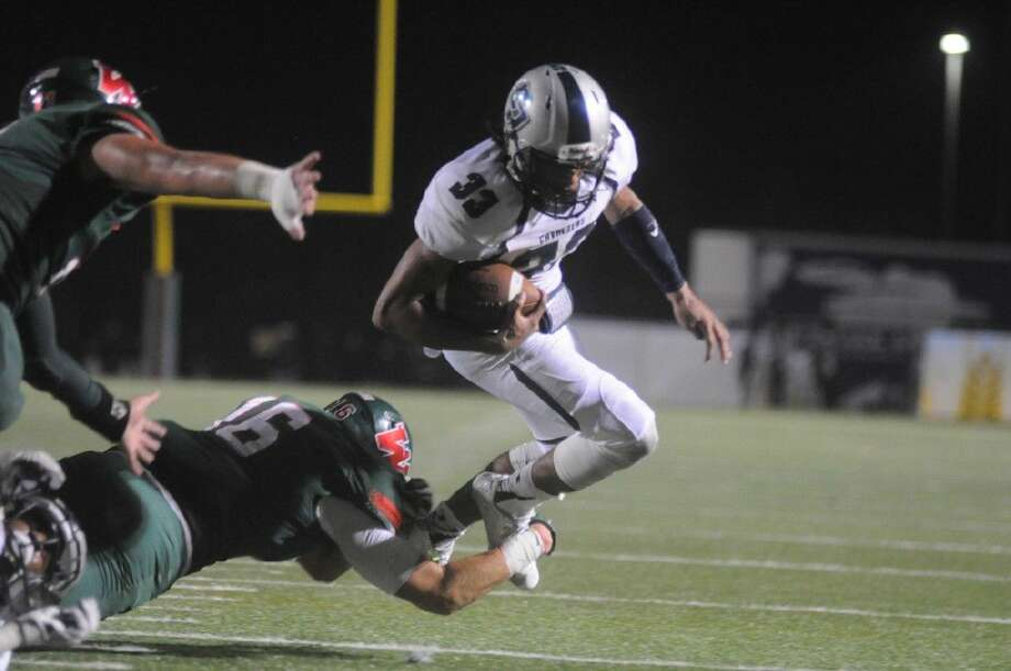The Woodlands' Zak Yhlecias trips up College Park's Dominic Garcia before reaching the end zone to force a turnover on downs on Friday at Woodforest Bank Stadium in Shenandoah.