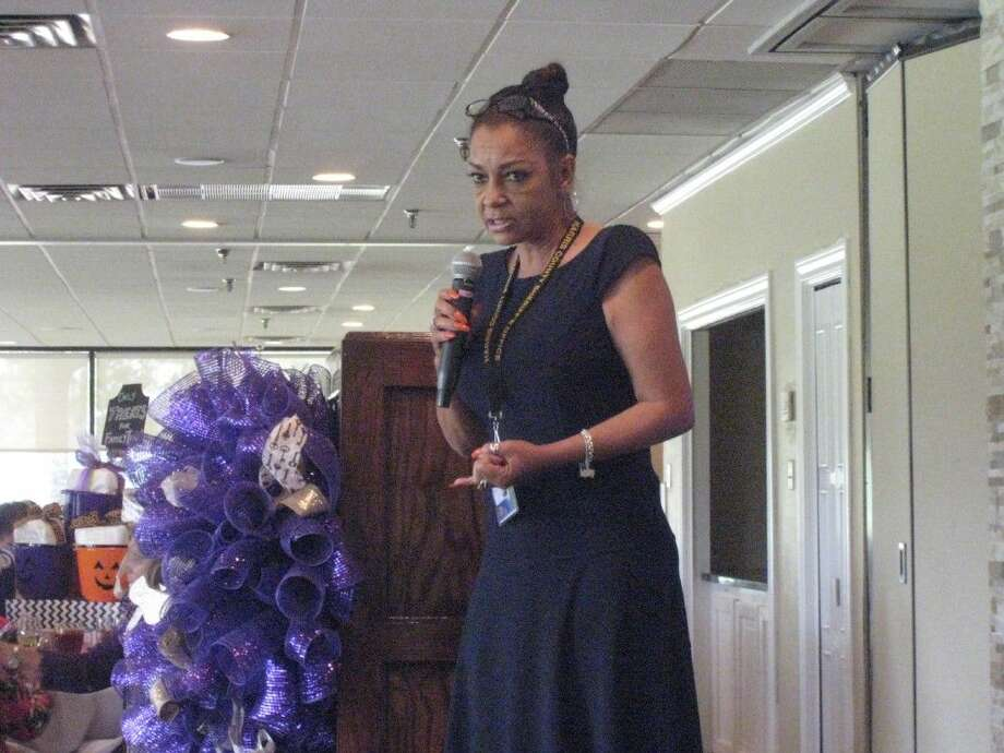 Kathryn Griffin-Townsend shares her story with guests at FamilyTime's annual Purple Ribbon luncheon Friday, Oct. 9, 2015.