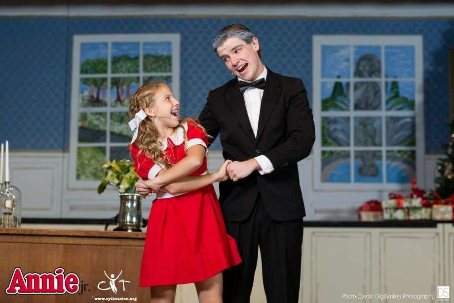 "Canon Wheatley and Elijah Flanery, as Annie and Oliver Warbucks, singing onstage during a dress rehearsal of ""Annie Jr."""