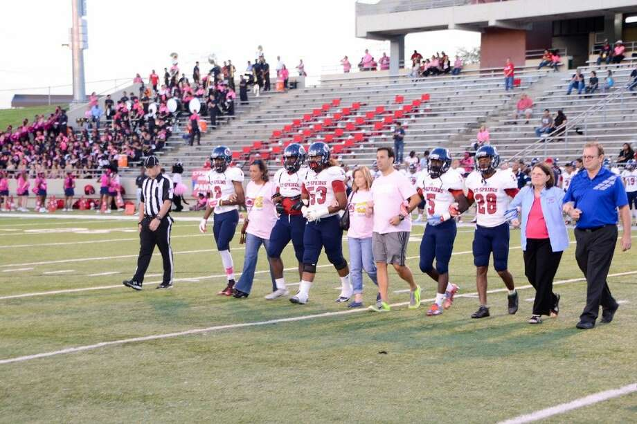 Cypress Springs High School's honorary captains are escorted onto the field by players, family and friends.