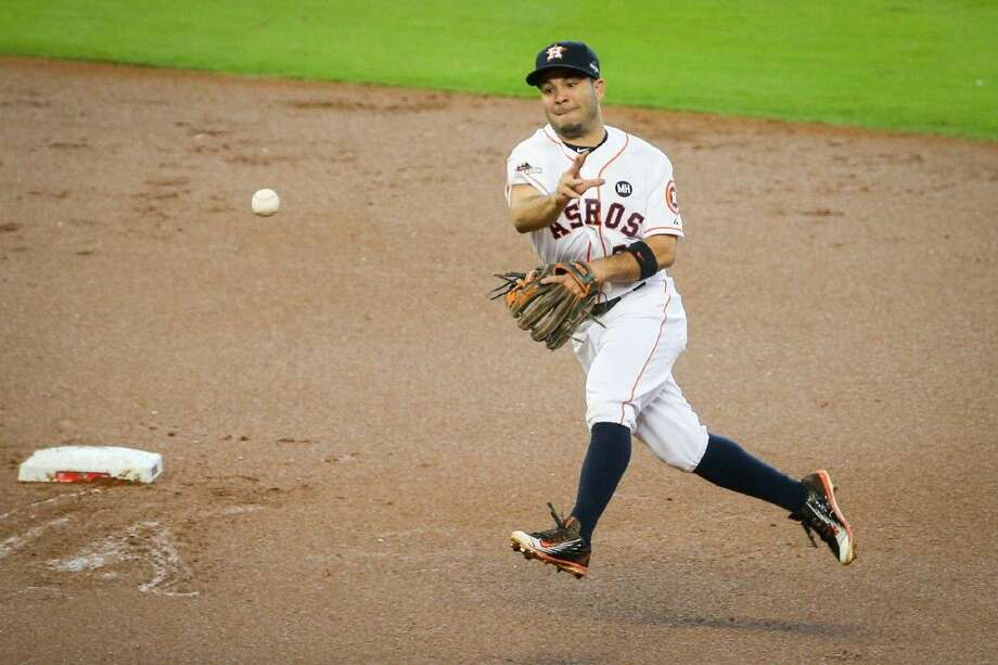 Houston Astros' Jose Altuve fields the ball to first base during the MLB baseball game against the Kansas City Royals on Sunday, Oct. 11, 2015, in Houston, Texas. Photo: Michael Minasi
