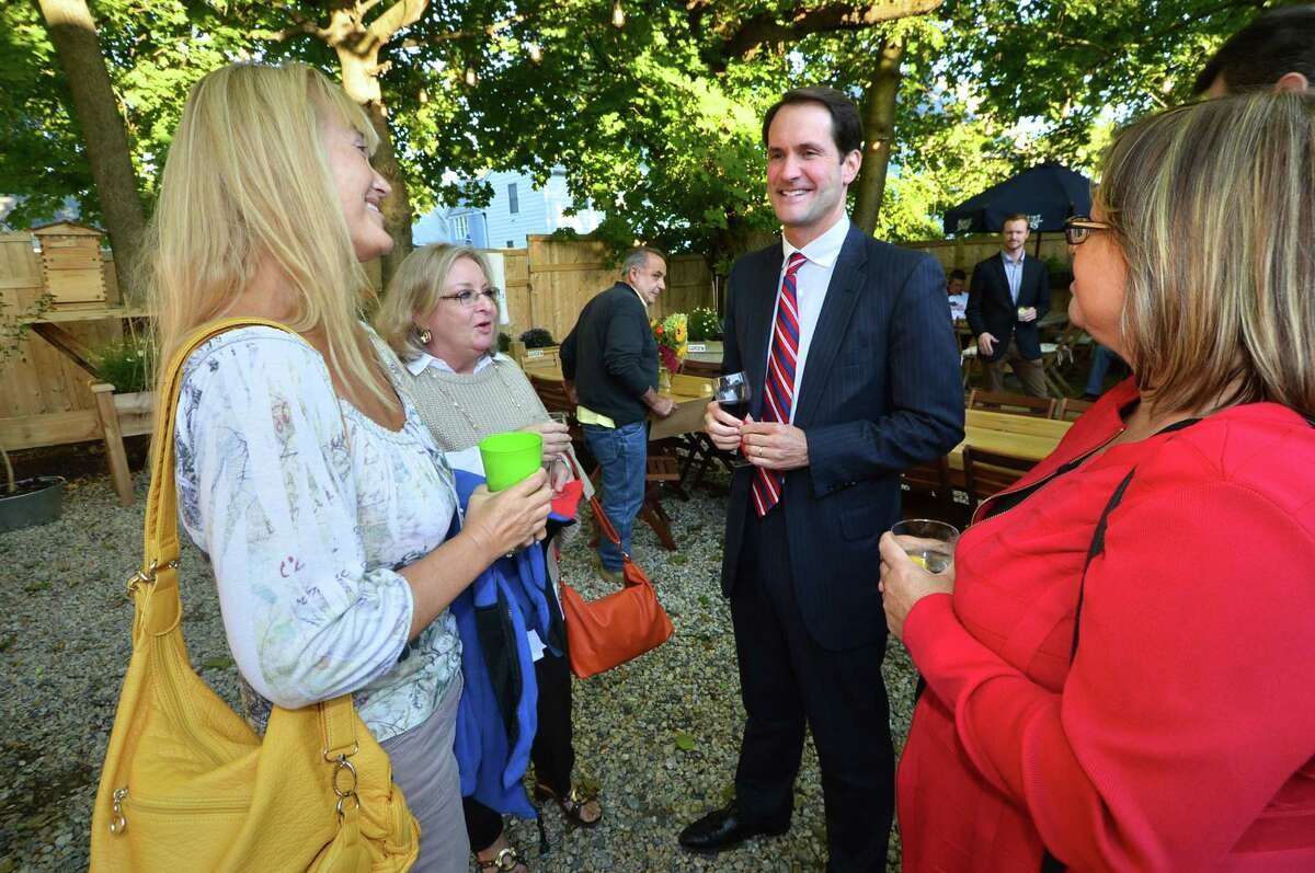 Incumbent Congressman Jim Himes talks with residents over a glass of wine and appetizers during the East Norwalk Business Association's Meet the Candidates forum at Harbor Harvest on Wednesday. Residents were able to ask questions and get to know U.S. Congressman Jim Himes, D-4, and other candidates.