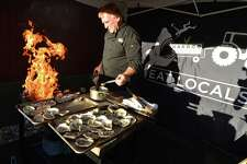 Harbor Harvest owner Bob Kunkel grills some roasted oysters for the East Norwalk Business Association 'Meet the Candidates' forum at Harbor Harvest on Wednesday October 5 2016. Residents were able to ask questions and get to know U.S. Congressman Jim Himes, D-4, Republican challenger John Shaban and  state Senate Majority Leader Bob Duff, D-Norwalk, and Republican challenger Greg Ehlers; and state Rep. Christopher R. Perone, D-Norwalk, and Republican challenger Darline Perpignan during the evnt in Norwalk Conn.