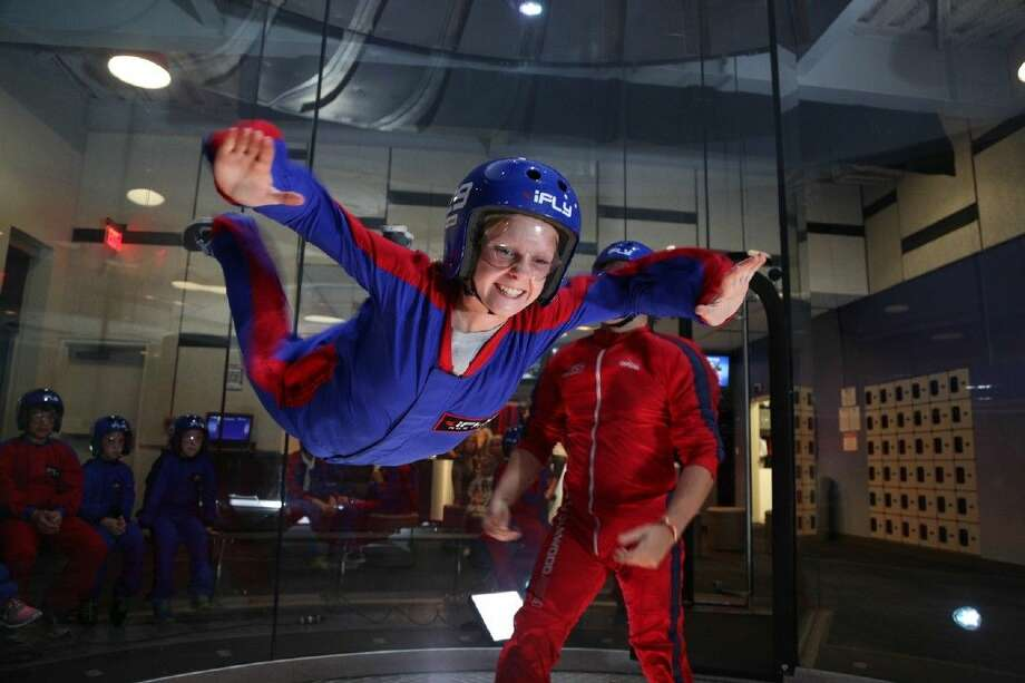 A person is airborn in an iFly tunnel. Photo: Alex Endress